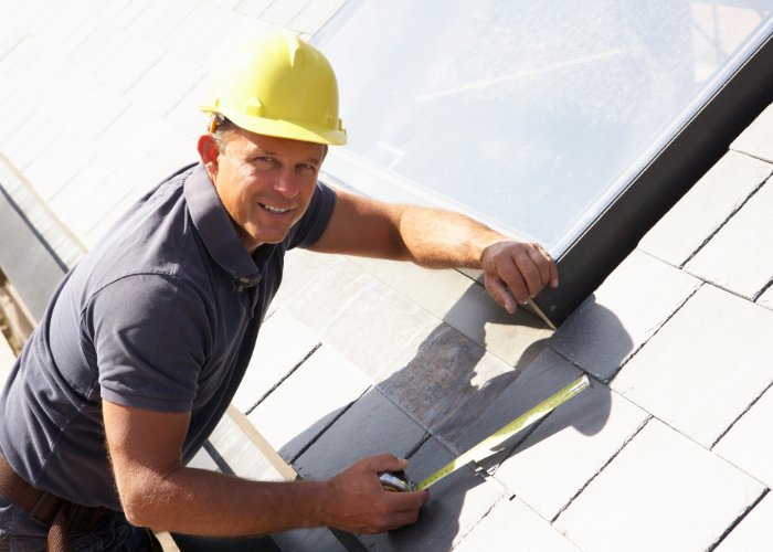 roofing contractor inspecting roof in Rhode Island